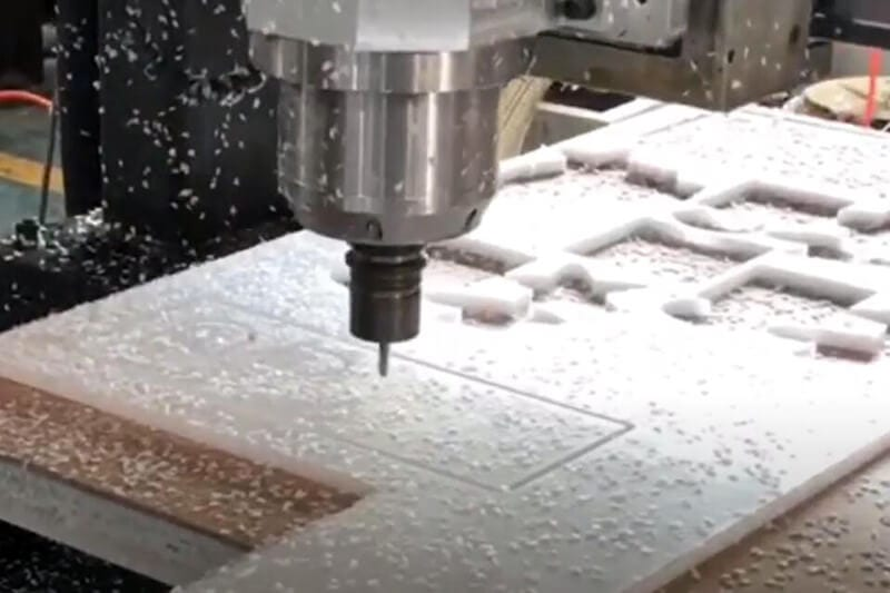 Engraving Machine Cuts Acrylic Sheet